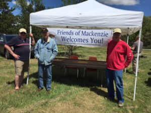 Neil Bishop, Larry Hahn, and Steve Wearne help set up the Friends tent for MOHEE.