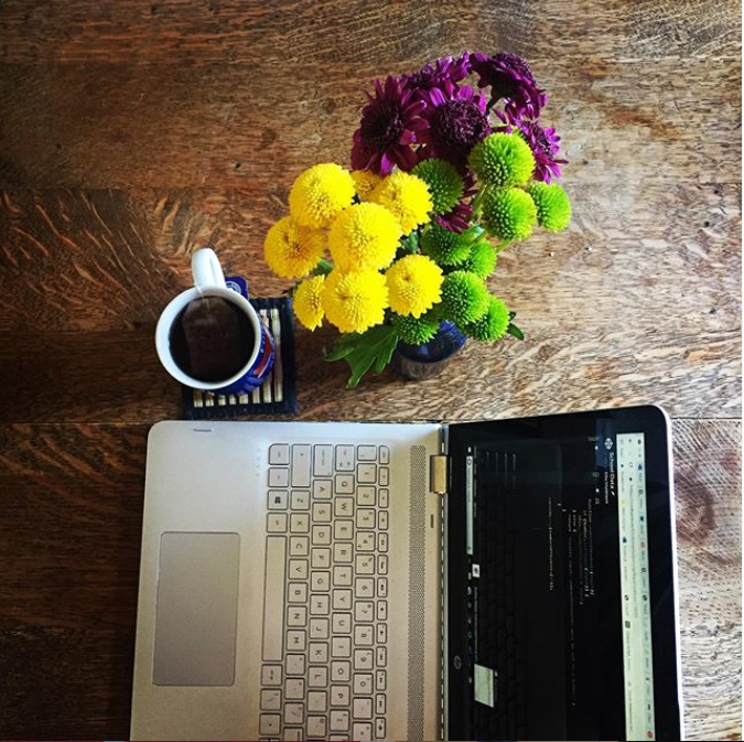 My Desk Set Up - Laptop, cup of tea and fresh cut flowers