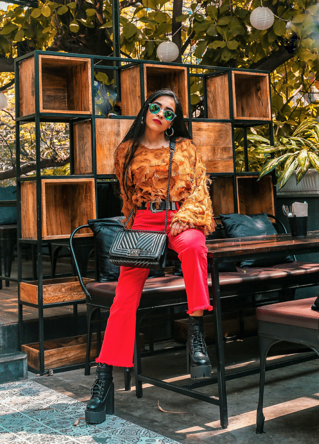 maximalism, oversized, ootd, indian blogger, feather top, shein, romwe, red, boots, red pants, hardcore accessories, black leather accessories, silver hardware, fashion week street style