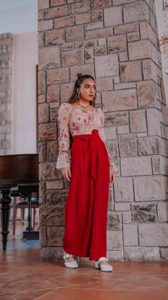 girl wearing nude floral top with red formal pants summer street style