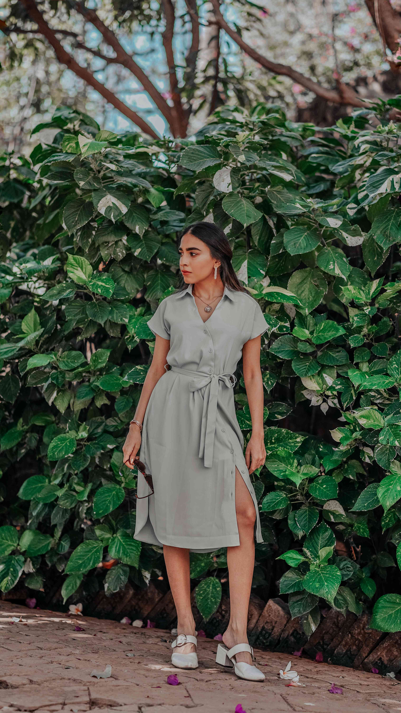Girl wearing dull green summer dress - summer street style
