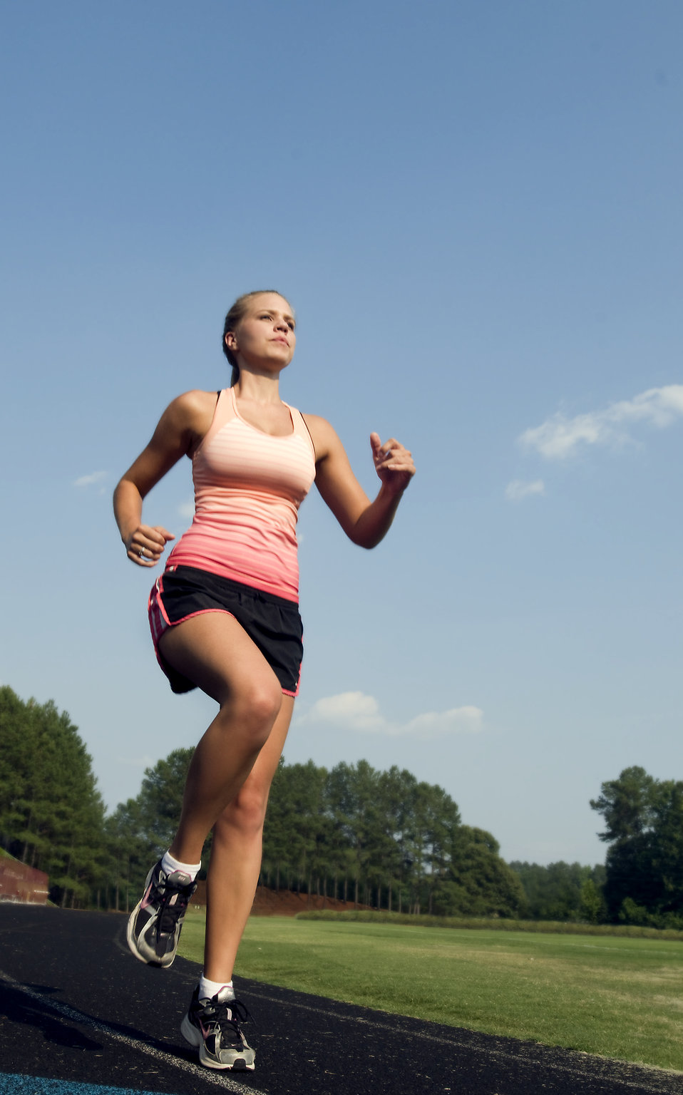 15322-a-healthy-young-woman-running-outdoors-on-a-track-pv