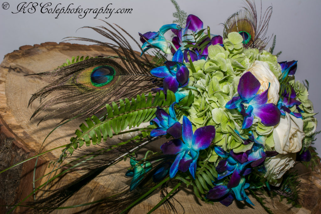 Blue Orchid and peacock feather bouquet