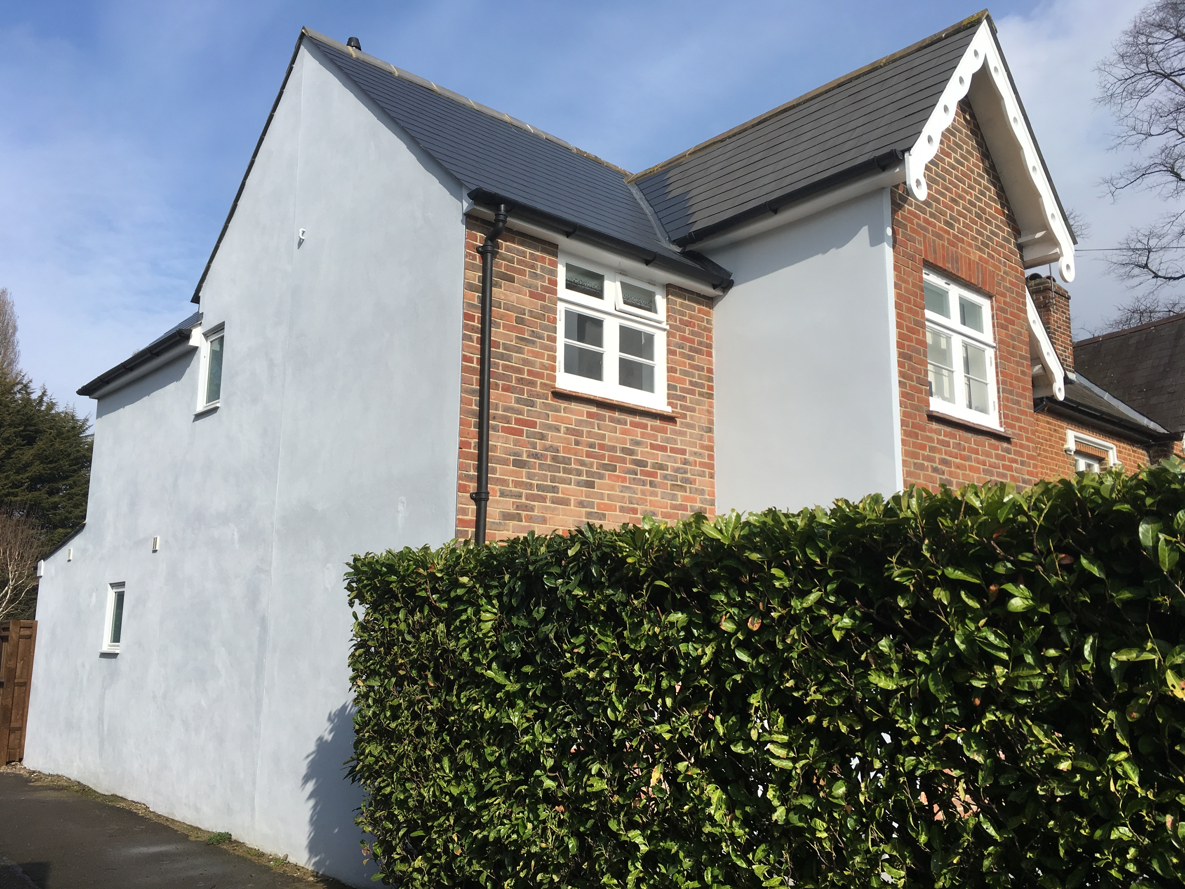 Two storey side and single storey rear addition in Ewell