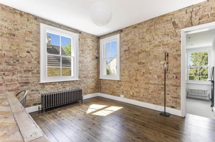 Exposed period brickwork with up to date sash windows and 21st century technology with victorian period detailing
