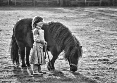 Farmer's daughter with her pony