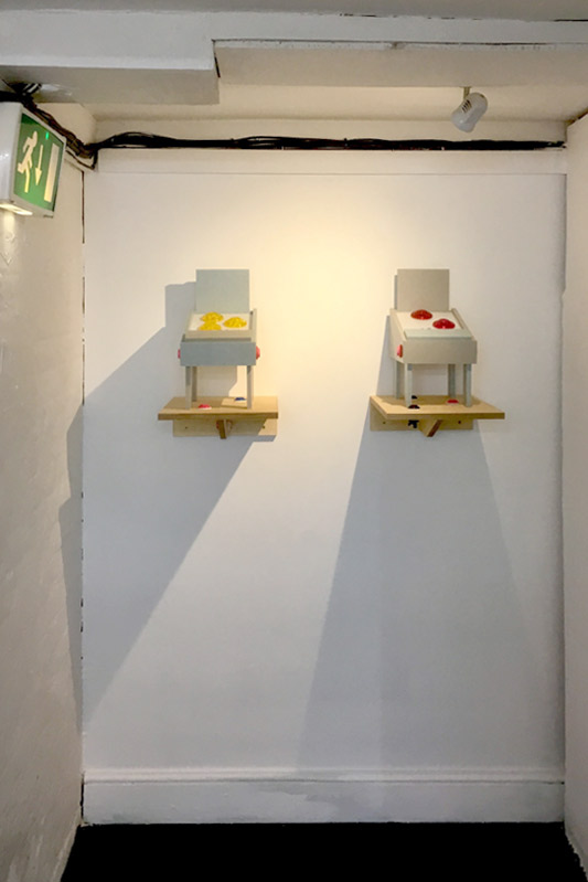 Ant Hamlyn: Unplayable Pinball Machines (2019) (Available in red or yellow) Sheet Corian, Perspex, Epoxy, Cabochon bulbs, Birch Plywood, Arcade buttons. (40 x 30 x 30cm).