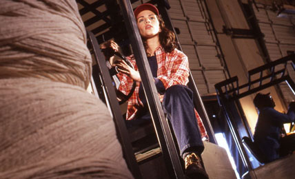 commercial photographer london photograph of woman driving forklift