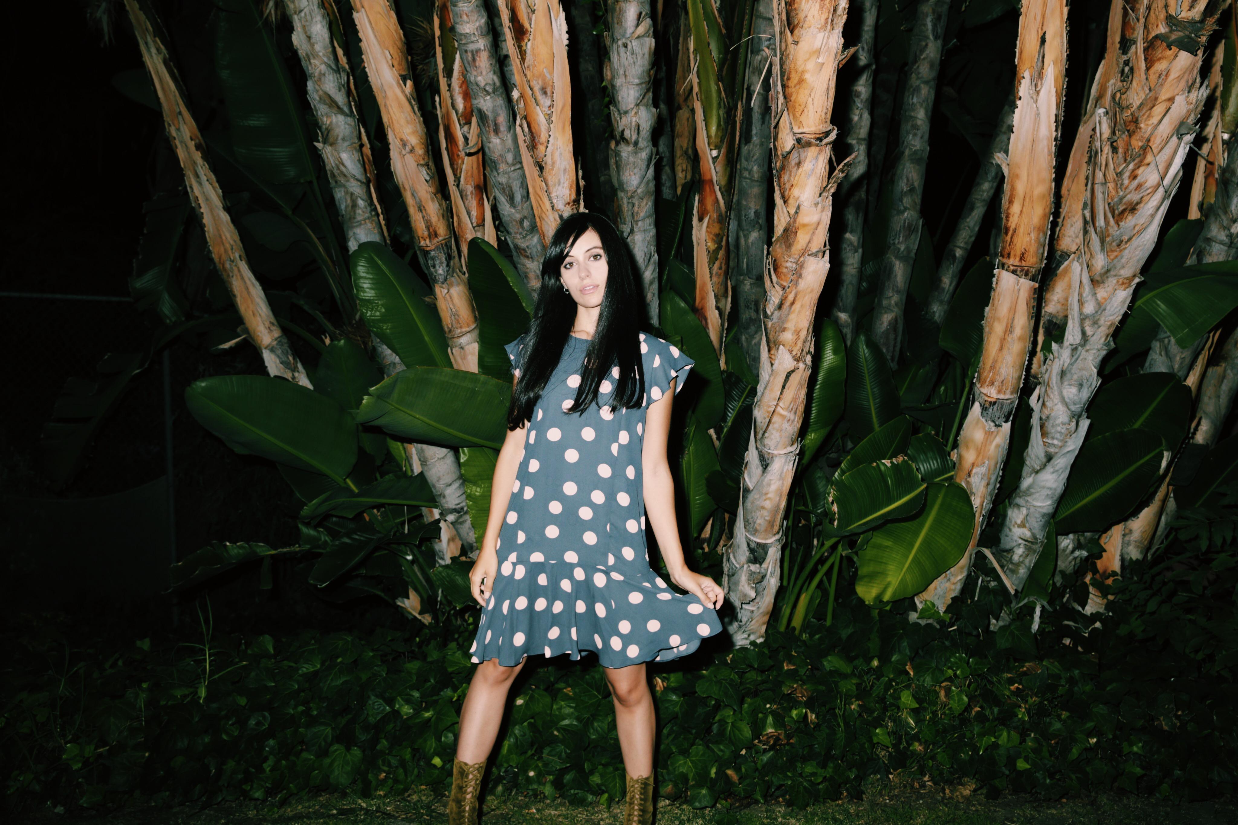 Blogger and actress Marta Pozzan wearing LOFT polka dots dress and Valas booties.