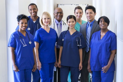 Portrait of smiling dedicated multi ethnic male female clinical nursing