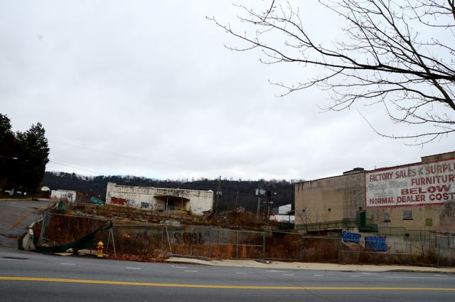 An undeveloped hole in the ground is the Coxe Avenue site of a proposed high-rise residential condo building that was to be called Zona Lofts.