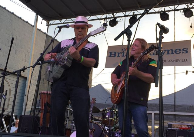 David Holt, left, with Warren Haynes at a New Mountain AVL concert in September 2015. The concert was a fundraising event for Haynes' brother, Brian Haynes, who was running for election to Asheville City Council, a race Brian Haynes won./ Photo by Jason Sandford
