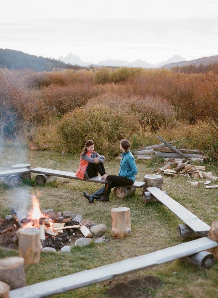 Girls around a firepit during sunset at Turpin Meadow Ranch in Grand Teton National Park