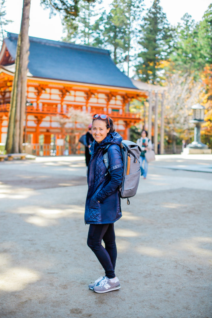 Travel Blogger wearing Athleta Rock Springs Jacket while visiting a shrine in Japan