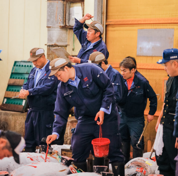 Auctioneer at Tsukiji Fish Market Auction in Tokyo