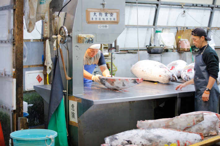 Tuna is sectioned and cut after the budding of the Tsukiji Fish Market in Tokyo