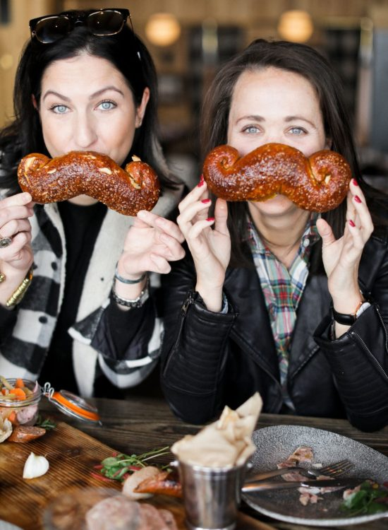 jackson hole blogger digs into mustache pretzel from the handle bar in the four season resort