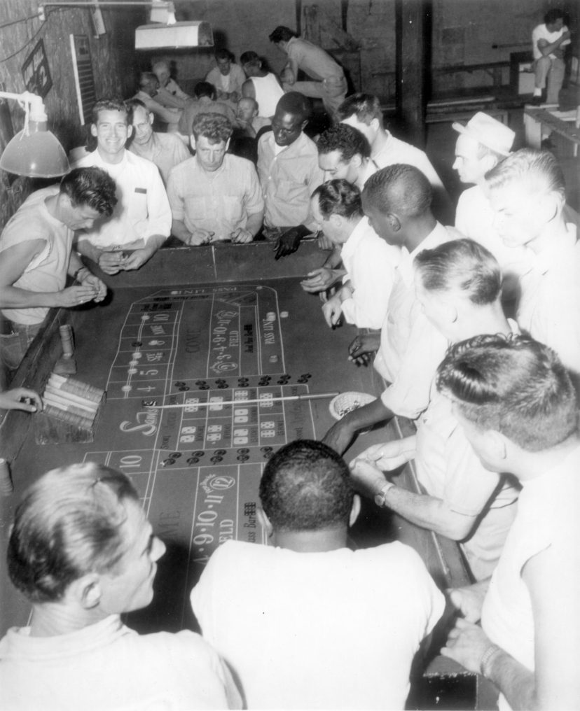 Inmates gathered around a craps table circa1960