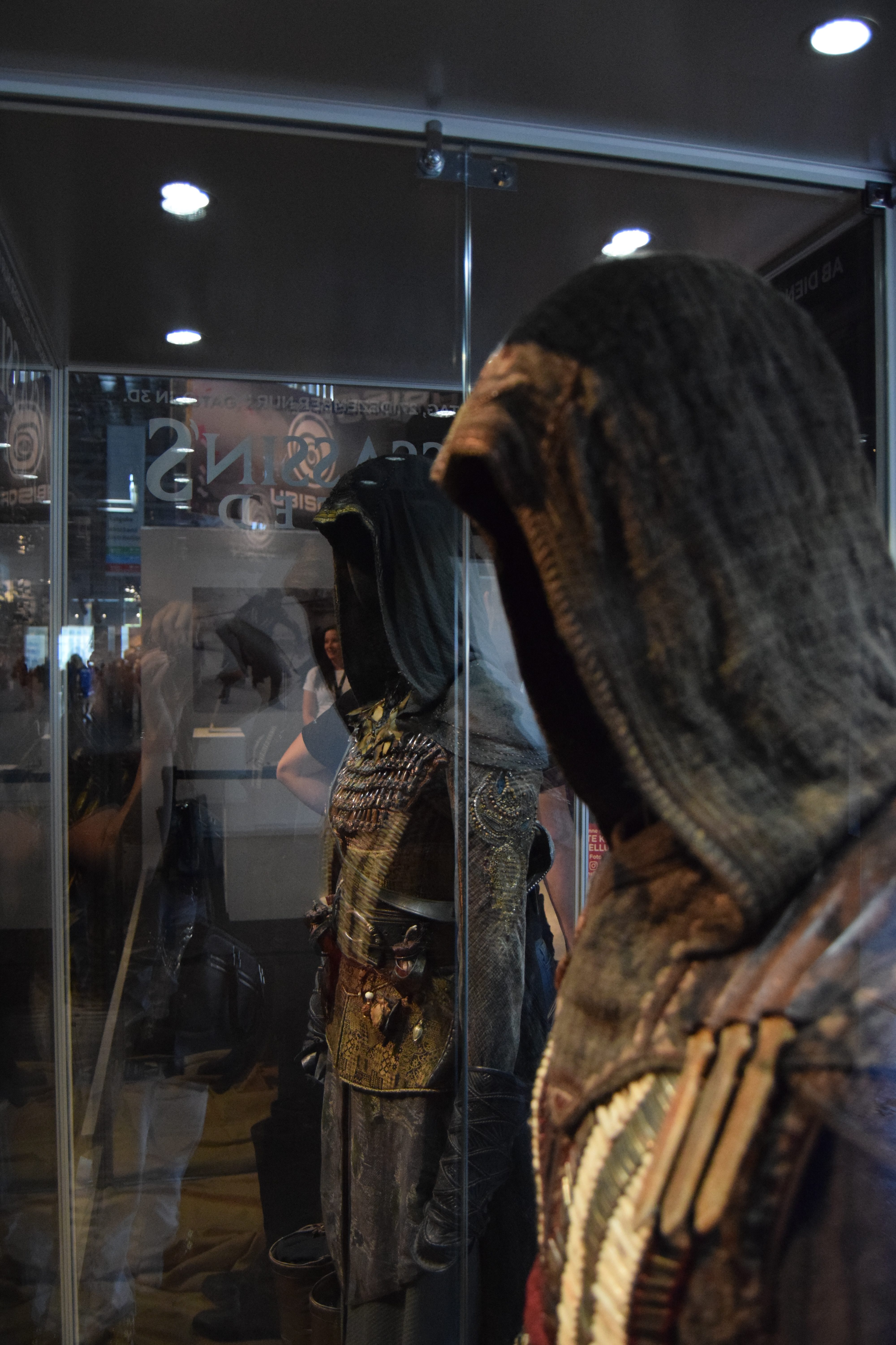 Aguilar and Maria's outfits displayed on mannequins at Gamescom