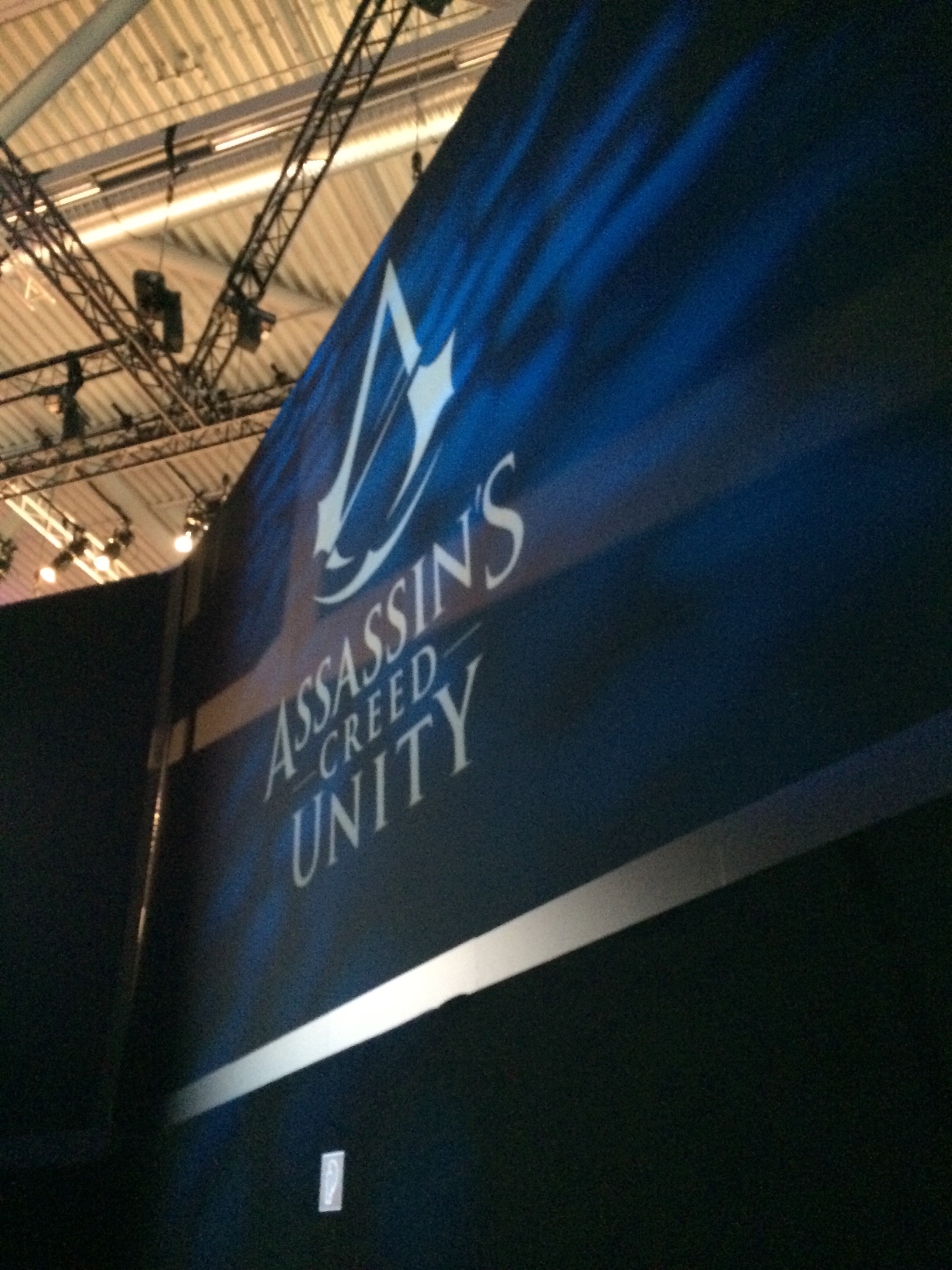 Assassin's Creed: Unity banner at the entrance of the Demo Theater