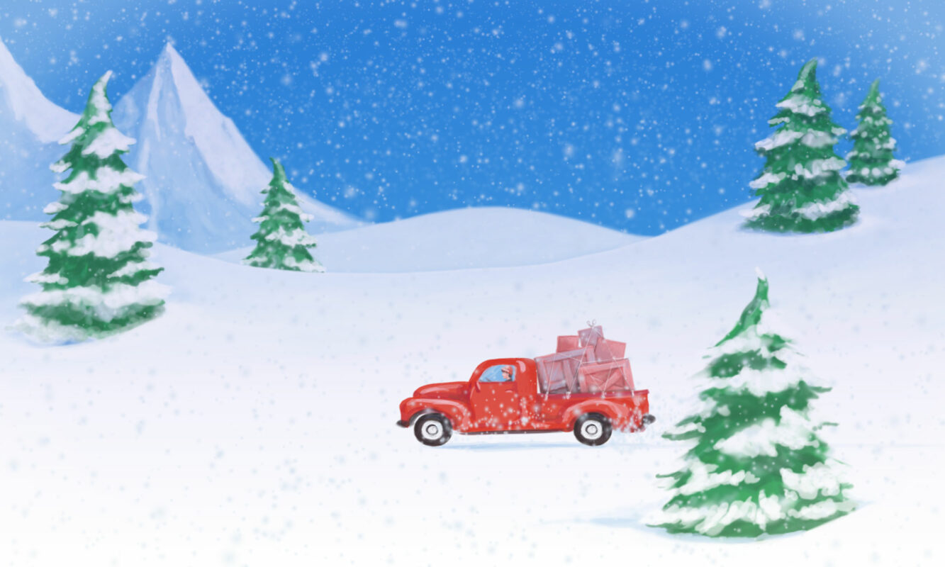 Red truck with boxes in back driving through snowy landscape