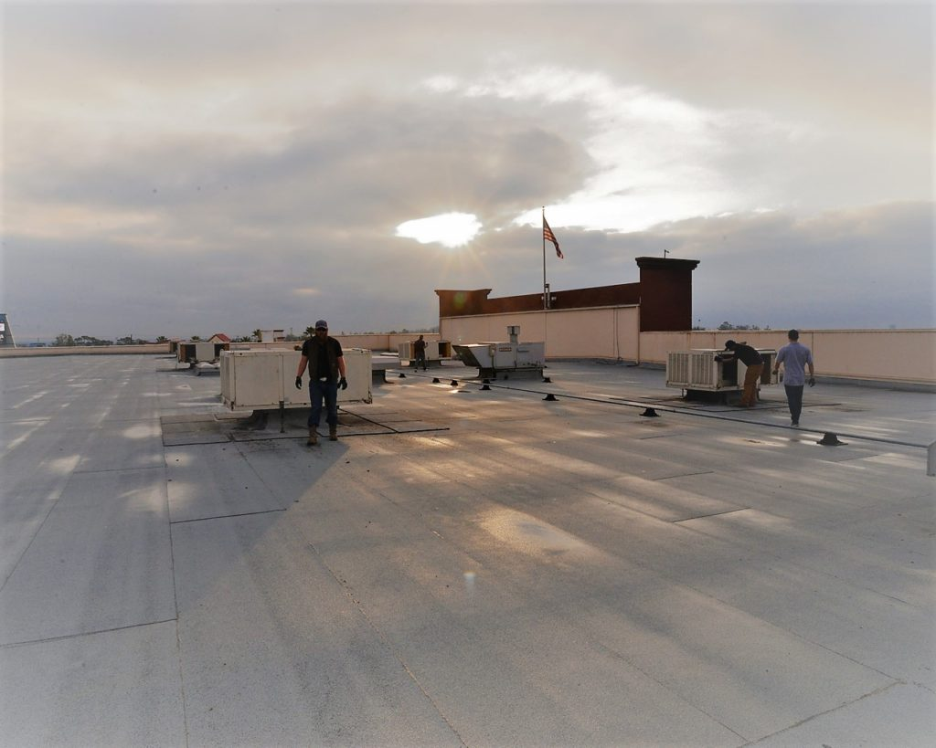 HVAC Commercial HVAC Rooftop photo of service men servicing Heating and Cooling system in Southern CA Warehouse Heating and warehouse cooling