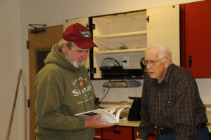 Ray Berry showing  his book