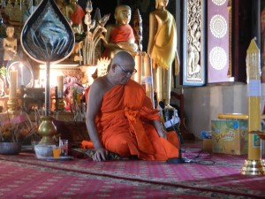 A late afternoon service in Wat Mahathat, Luang Prabang, Laos.