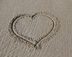 heart-drawn-in-sand