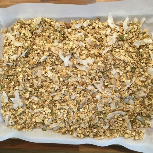 wet-granola-spread-on-baking-sheet-before-baked