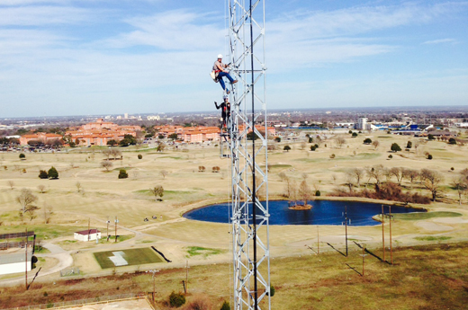 two guys on tower