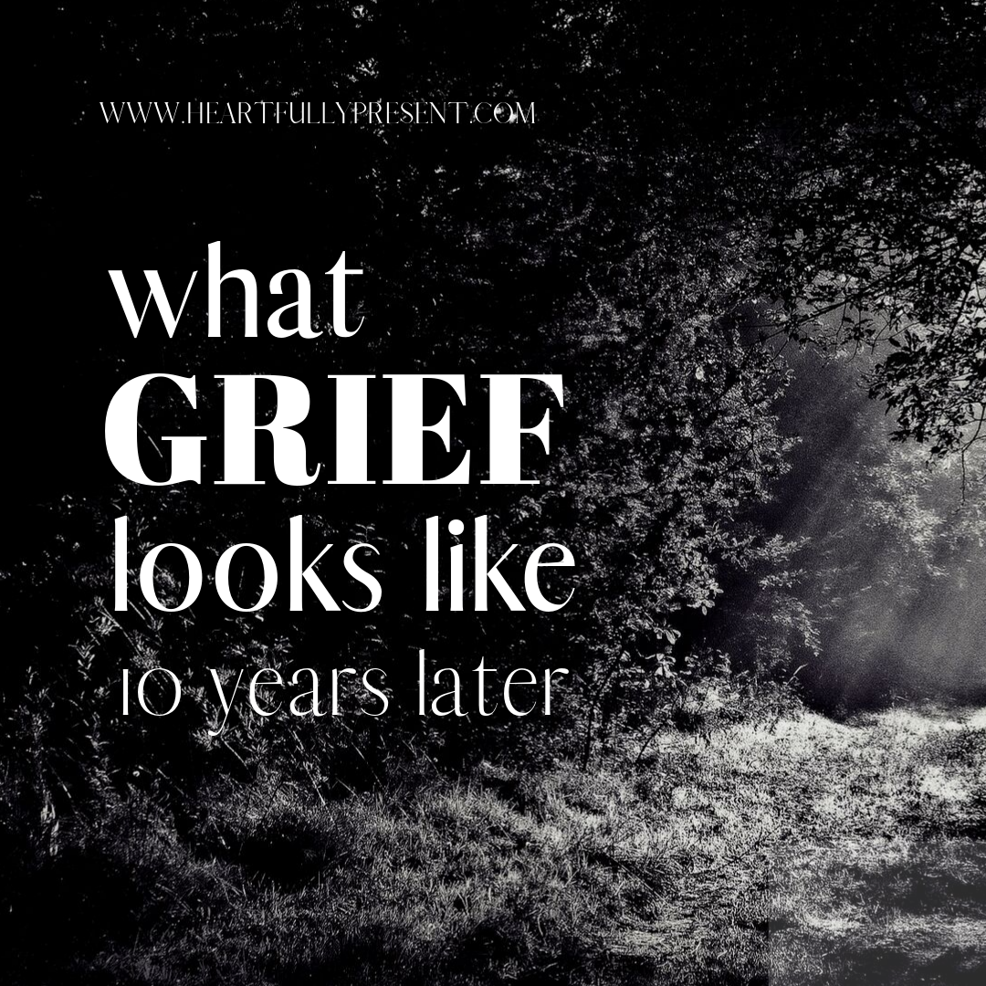 what grief looks like 10 years later   dark path with light   black and white photo of light at the end of the tunnel