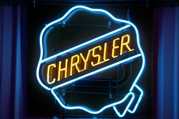 Blue and yellow lighted Chrysler logo neon sign.