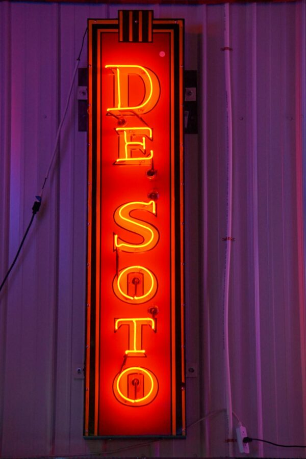 Lighted DeSoto vertical red and yellow neon sign.
