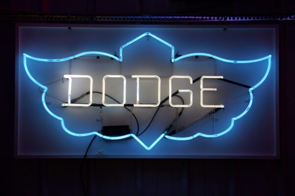 Lighted Dodge blue and white wing neon sign.