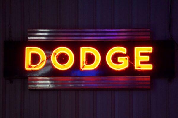 Lighted Dodge horizontal orange and blue neon sign.