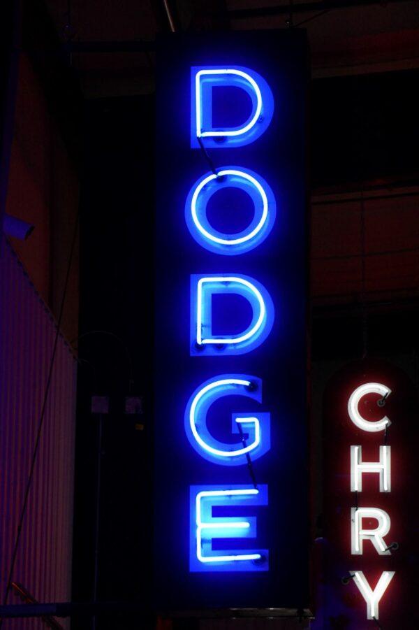 Lighted Dodge vertical blue neon sign.