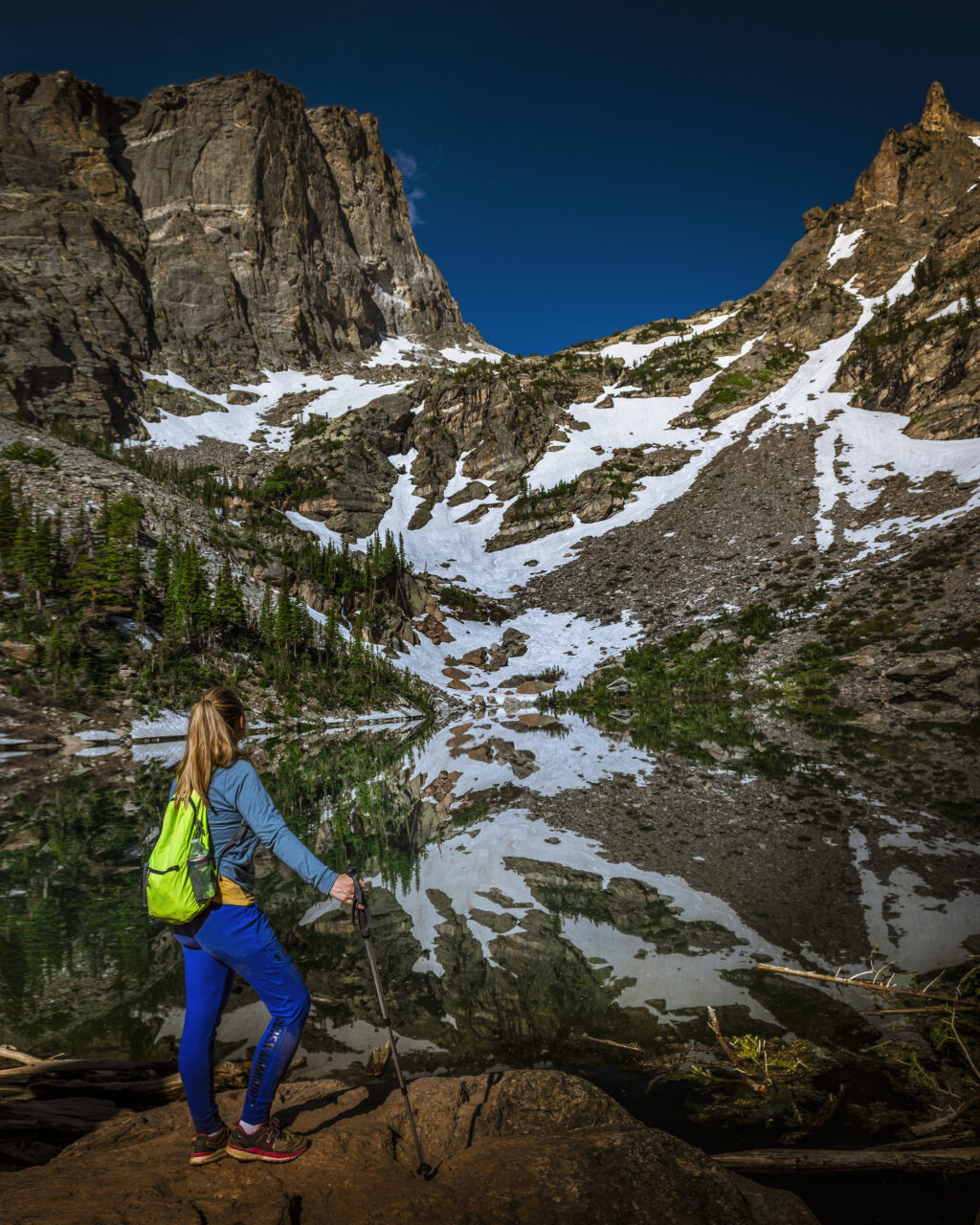 Kat views the reflection of Hallet Peak in a glassine Emerald Lake.