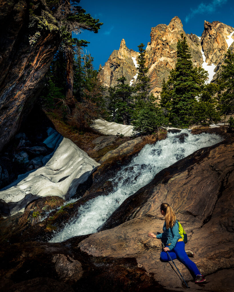 Kat gets a closer look at a waterfall along the trail to Emerald Lake at Rocky Mountain National Park.
