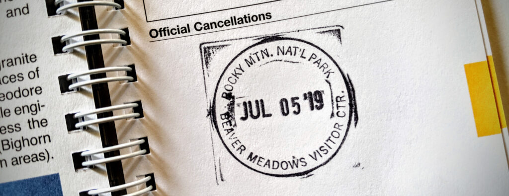 Rocky Mountain National Park rubber stamp cancellation in National Parks passport book.