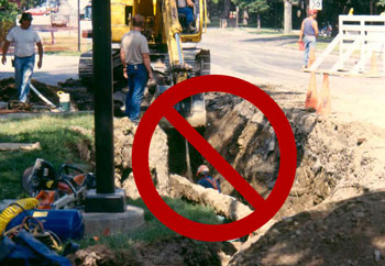 Worker inside a freshly-excavated trench- DO NOT DO THIS.