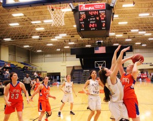 Hayley Hatfield fights to make a basket early Tuesday night at the Sumter Civic Center.