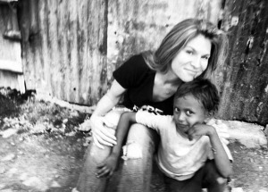 Tiffany Johnson poses with a child who received shoes through Soles4Souls.