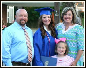 Stefani Henshaw, standing right, with her family, husband Jason Henshaw, left, daughter Hannah Henshaw, center, and daughter Emma Henshaw, center-right.
