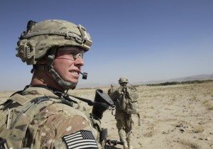 Image: A platoon sergeant looks at comrades in Kandahar province
