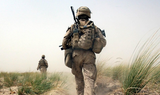 Troops in Afghanistan.American Marines on patrol in Khan Neshin, Helmand Province, Afghanistan, the furthest south of any coalition troops and near the border of Pakistan. Picture date: Tuesday August 25, 2009. Its the furthest south of any coalition troops and near the border of Pakistan, the Marines have taken over an 18th century castle after removing the Taliban from occupying it. Photo credit should read: Lewis Whyld/PA Wire URN:7740709 (Press Association via AP Images)
