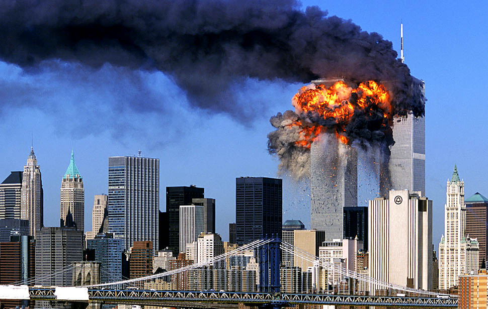SEVENTH IN A PACKAGE OF NINE PHOTOS.-- An explosion rips through the South Tower of the World Trade Towers after the hijacked United Airlines Flight 175, which departed from Boston en route for Los Angeles, crashed into it Sept, 11, 2001. The North Tower is shown burning after American Airlines Flight 11 crashed into the tower at 8:45 a.m.