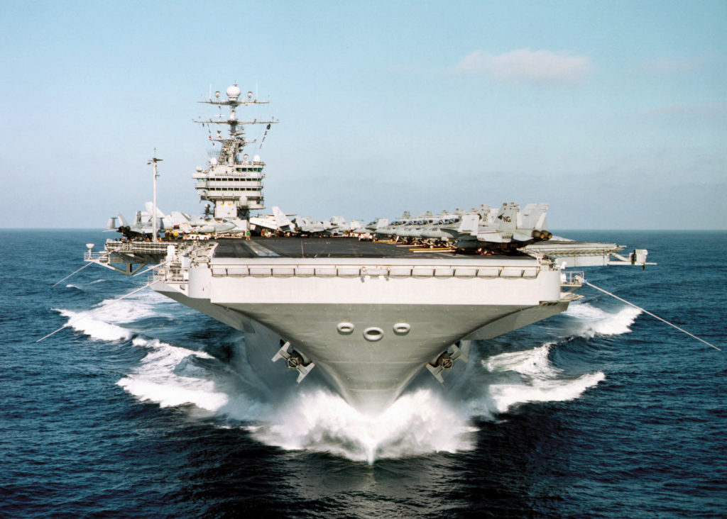 The aircraft carrier USS JOHN C. STENNIS (CVN 74) plows through the calm Pacific waters off the coast of Southern California at 28 knots during Competitive Training Exercise (COMPTUEX) August 22, 1999.