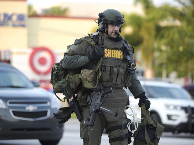 An Orange County Sheriff's Department SWAT member arrives to the scene of a fatal shooting at Pulse Orlando nightclub in Orlando, Fla., Sunday, June 12, 2016. (AP Photo/Phelan M. Ebenhack)