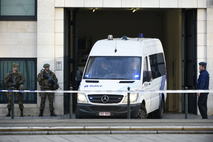 """A police vehicle leaves Brussels courthouse on April 14, 2016, during the detention hearing of top Paris and Brussels attacks suspect Mohammed Abrini with suspected bomber Osama Krayem and two other suspects. Paris attacks suspect Mohamed Abrini confessed on April 10 to being """"the man in the hat"""" caught on video with suicide bombers at Brussels airport last month, images that had sparked a massive manhunt. / AFP / JOHN THYS (Photo credit should read JOHN THYS/AFP/Getty Images)"""